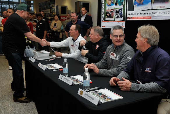 Football coaches meet fans during the 2016 Coaches Tour Feb. 14, 2016, at Ramstein Air Base, Germany. The coaches who attended the tour are Troy Calhoun, Air Force Academy head coach, Chip Kelly, San Francisco 49ers head coach, Chris Creighton, Eastern Michigan University head coach, and Patrick Steenberge, Global  Football founder. (U.S. Air Force photo/Airman 1st Class Larissa Greatwood)