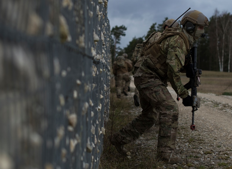 An Airman with the 2nd Air Support Operations Squadron, maneuvers to the objective during training at U.S. Army Garrison Bavaria in Vilseck, Germany, Feb. 9, 2016. The training consisted of 2nd ASOS Airmen calling in close air support, neutralizing opposing forces and practicing medical evacuation by helicopter. The Airmen swapped roles as opposing forces and U.S. forces throughout the training to challenge their capabilities in controlling air power in an urban environment. (U.S. Air Force photo/Senior Airman Jonathan Stefanko)