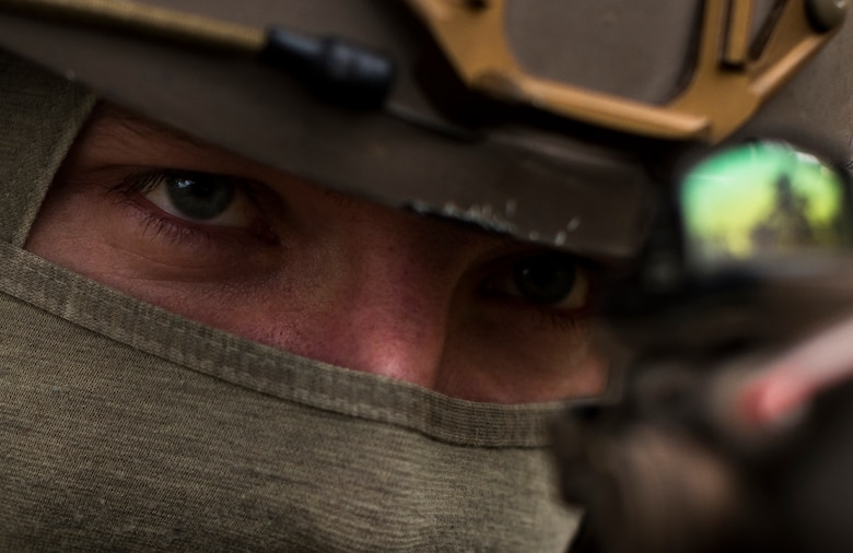 Senior Airman Martin Dietrich, 2nd Air Support Operations Squadron tactical air control party member, looks through the scope on his weapon during training at U.S. Army Garrison Bavaria in Vilseck, Germany, Feb. 8, 2016. The training consisted of Airmen calling in close air support, neutralizing opposing forces and practicing medical evacuation by helicopter. The role of an ASOS Airman is to be the subject matter expert on available air capabilities are for the ground commander. (U.S. Air Force photo/Senior Airman Jonathan Stefanko)