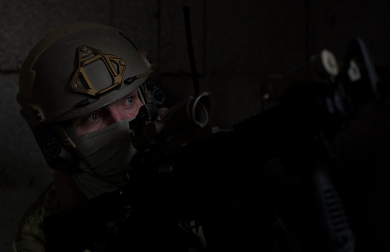 Senior Airman Martin Dietrich, 2nd Air Support Operations Squadron tactical air control ember, watches for opposing forces during training at U.S. Army Garrison Bavaria in Vilseck, Germany, Feb. 8, 2016. The training consisted of 2nd ASOS Airmen calling in close air support, neutralizing opposing forces and practicing medical evacuation by helicopter. By conducting the training in an urban environment the ASOS team was forced to think about proper tactics to ensure they weren't caught in the line of fire. (U.S. Air Force photo/Senior Airman Jonathan Stefanko)
