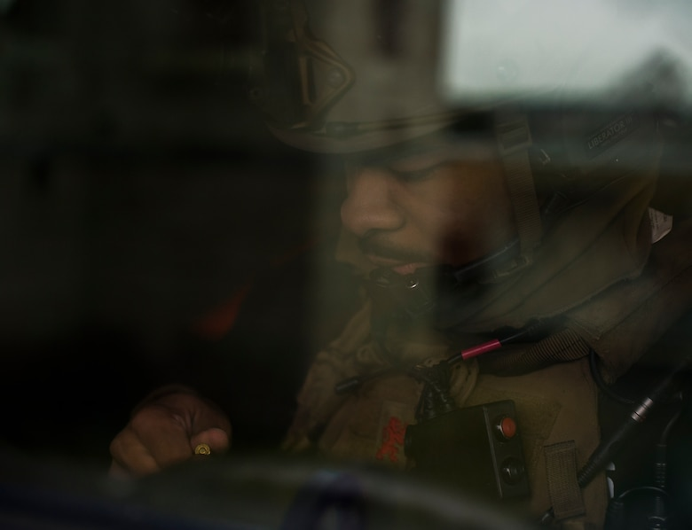 Senior Airman Deshaun Dixon, 2nd Air Support Operations Squadron, 2nd Air Support Operations Squadron joint terminal attack controller, loads his magazine with blank rounds during training at U.S. Army Garrison Bavaria in Vilseck, Germany, Feb. 9, 2016. The training consisted of 2nd ASOS Airmen calling in close air support, neutralizing opposing forces and practicing medical evacuation by helicopter. (U.S. Air Force photo/Senior Airman Jonathan Stefanko)