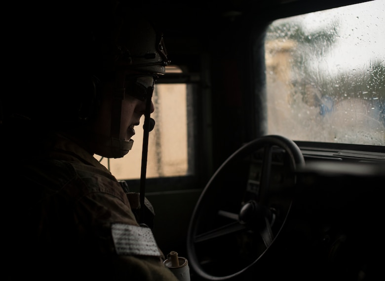 Senior Airman Logan Bennett, 2nd Air Support Operations Squadron joint terminal attack controller, drives through a simulated urban village during training at U.S. Army Garrison Bavaria in Vilseck, Germany, Feb. 9, 2016. The training consisted of 2nd ASOS Airmen calling in close air support, neutralizing opposing forces and practicing medical evacuation by helicopter. All ASOS Airmen begin their career as a tactical air control party. JTAC is a status earned after completing on-the-job training and thus qualified to call close air support. (U.S. Air Force photo/Senior Airman Jonathan Stefanko)