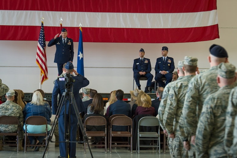 U.S. Air Force Col. Paul Lyman gives his first salute as the 153rd Airlift Wing commander during a change of command ceremony, Feb. 13, 2016 in Cheyenne, Wyoming. (U.S. Air National Guard photo by Master Sgt. Charles Delano/released)