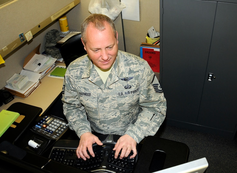 U.S. Air Force Master Sgt. Jeffery Harwood, 145th Comptroller Flight, works with Defense Enterprise Accounting System (DEAMS) site lead, from the North Carolina Air National Guard Base, Charlotte Douglas International Airport, Feb. 12, 2016.  Harwood is part of the 145th CPTF, Budget Office Team who was recently recognized by the Secretary of the Air Force Finance Management Programs office as being the first of 25, including all Active Duty, Reserve and Guard units, to have accurately completed all pre-work required for a smooth transaction when DEAMS goes live March 1, 2016. (U.S. Air National Guard photo by Master Sgt. Patricia F. Moran/Released)