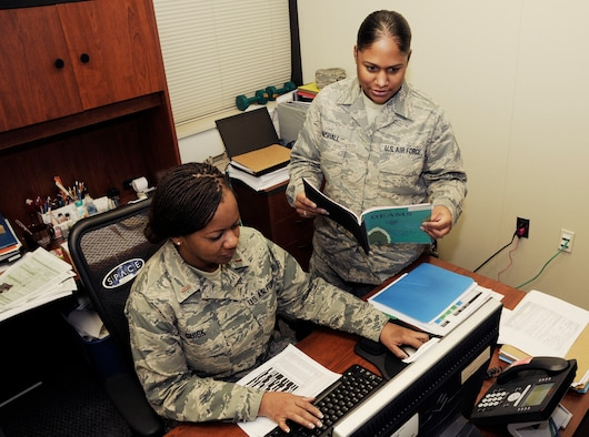 U.S. Air Force 2nd Lt. Joyce A. Quick and Tech. Sgt. Sarah Marshall, 145th Comptroller Flight, review Defense Enterprise Accounting System (DEAMS) training schedule to ensure all users receive proper training prior to March 1, 2016, when DEAMS goes live. Quick and Marshall are part of the 145th CPTF, Budget Office Team, located at the North Carolina Air National Guard Base, Charlotte Douglas International Airport, who were recently recognized by the Secretary of the Air Force Finance Management Programs office as being the first of 25, including all Active Duty, Reserve and Guard units, to have accurately completed all pre-work required for a smooth transaction when DEAMS goes live March 1, 2016. (U.S. Air National Guard photo by Master Sgt. Patricia F. Moran/Released)