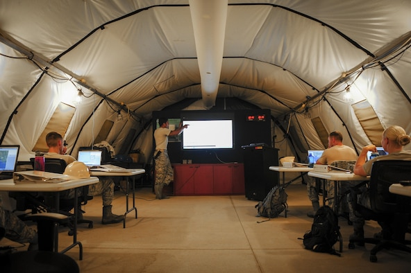Senior Airman Robert Wyka, a weather systems technician with the 2nd Combat Weather Systems Squadron, inspects the assembly of a TMQ-53 weather system with Senior Airman Cody Stebbis, a weather Airman from Ft. Carson, Colo., during pre-deployment training at Hurlburt Field, Fla., July 21, 2015. 2 CWSS is the Air Force's primary facility to test and evaluate new and existing tactical and fixed weather systems, train Airmen on tactical systems prior to deployment and provide manpower for the Weather Systems Support Cadre. (U.S. Air Force photo by Senior Airman Meagan Schutter)