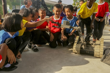 Children at Kao Chi Chan School, Sattahip District, Thailand, interact with explosive ordnance disposal robots during exercise Cobra Gold, Feb. 14, 2016. Cobra Gold, in its 35th iteration, includes a specific focus on humanitarian civic action, community engagement and medical activities conducted during the exercise to support the needs and humanitarian interests of civilian populations around the region.