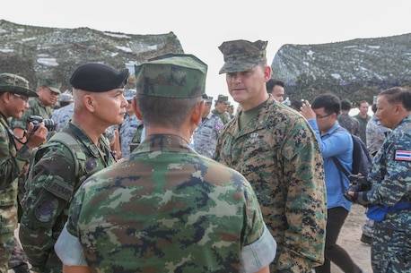 U.S. Marine Corps Brigadier General Russell A. Sanborn, Commanding General, 1st Marine Aircraft Wing speaks with members of the Royal Thai armed forces during an amphibious capabilities demonstration at Hat Yao beach, Rayong, Thailand, during exercise Cobra Gold 16, Feb. 12, 2016. CG16 a multinational training exercise developed to strengthen security and interoperability between the Kingdom of Thailand, the U.S. and other participating nations.