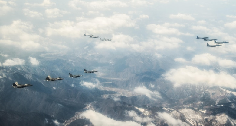 "Four U.S. Air Force F-22 ""Raptor"" fighter aircraft from Kadena Air Base, Japan, fly over the skies of South Korea, in response to recent provocative action by North Korea Feb. 17, 2016. The Raptors were joined by four F-15 Slam Eagles and U.S. Air Force F-16 Fighting Falcons. The F-22 is designed to project air dominance rapidly and at great distances and currently cannot be matched by any known or projected fighter aircraft.  (U.S. Air Force photo by Airman 1st Class Dillian Bamman/Released)"