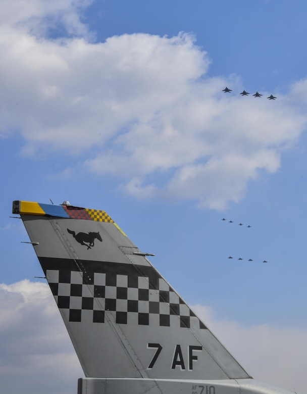 """Four U.S. Air Force F-22 """"Raptor"""" fighter aircraft from Kadena Air Base, Japan, conducted a flyover in the vicinity of Osan Air Base, South Korea, in response to recent provocative action by North Korea Feb. 17, 2016. The Raptors were joined by four F-15 Slam Eagles and U.S. Air Force F-16 Fighting Falcons. The F-22 is designed to project air dominance rapidly and at great distances and currently cannot be matched by any known or projected fighter aircraft.  (U.S. Air Force photo by Tech. Sgt. Travis Edwards/Released)"""