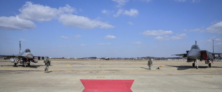 """A U.S. Air Force F-22 """"Raptor"""" fighter aircraft from Kadena Air Base, Japan, lands after conducting a flyover in the vicinity of Osan Air Base, South Korea, in response to recent provocative action by North Korea Feb. 17, 2016. Four Raptors were joined by four F-15 Slam Eagles and U.S. Air Force F-16 Fighting Falcons. The F-22 is designed to project air dominance rapidly and at great distances and currently cannot be matched by any known or projected fighter aircraft.  (U.S. Air Force photo by Tech. Sgt. Travis Edwards/Released)"""