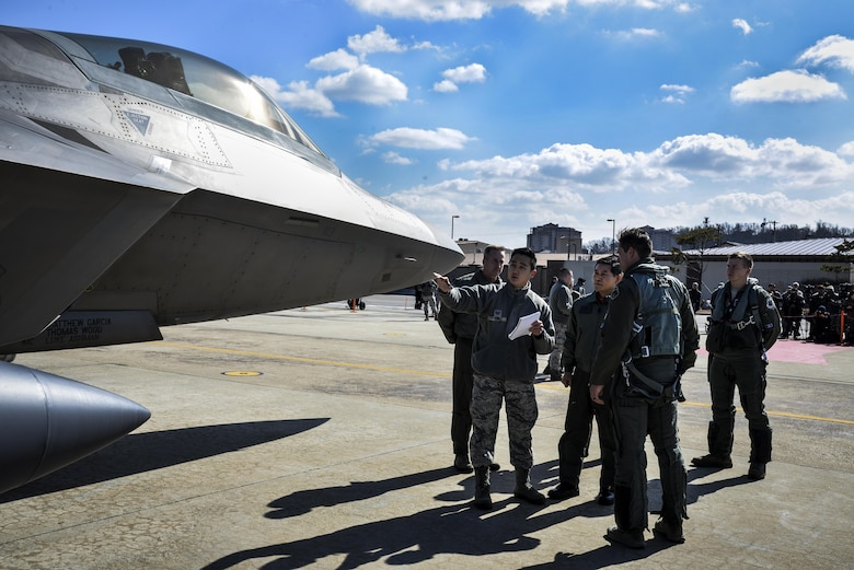 Chief of Staff of the Republic of Korea air force Gen. Jeong, Kyeong-doo (middle) receives a translated briefing from an F-22 Raptor pilot after conducting a flyover in the vicinity of Osan Air Base, South Korea, in response to recent provocative action by North Korea Feb. 17, 2016. F-22 Raptors were joined by four F-15 Slam Eagles and U.S. Air Force F-16 Fighting Falcons. The F-22 is designed to project air dominance rapidly and at great distances and currently cannot be matched by any known or projected fighter aircraft.  (U.S. Air Force photo by Tech. Sgt. Travis Edwards/Released)