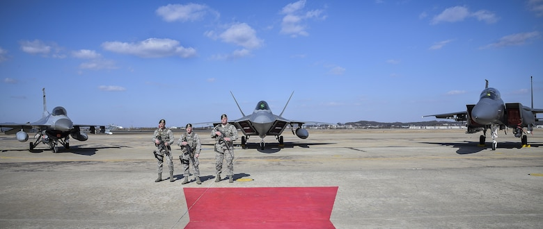 Air Force Security Forces members stands guard next to an F22 Raptor fighter aircraft from Kadena Air Base, Japan, after it conducted a flyover in the vicinity of Osan Air Base, South Korea, in response to recent provocative action by North Korea Feb. 17, 2016. It was joined by three other Raptors, four F-15 Slam Eagles and four U.S. Air Force F-16 Fighting Falcons. The F-22 is designed to project air dominance rapidly and at great distances and currently cannot be matched by any known or projected fighter aircraft.  (U.S. Air Force photo by Tech. Sgt. Travis Edwards/Released)