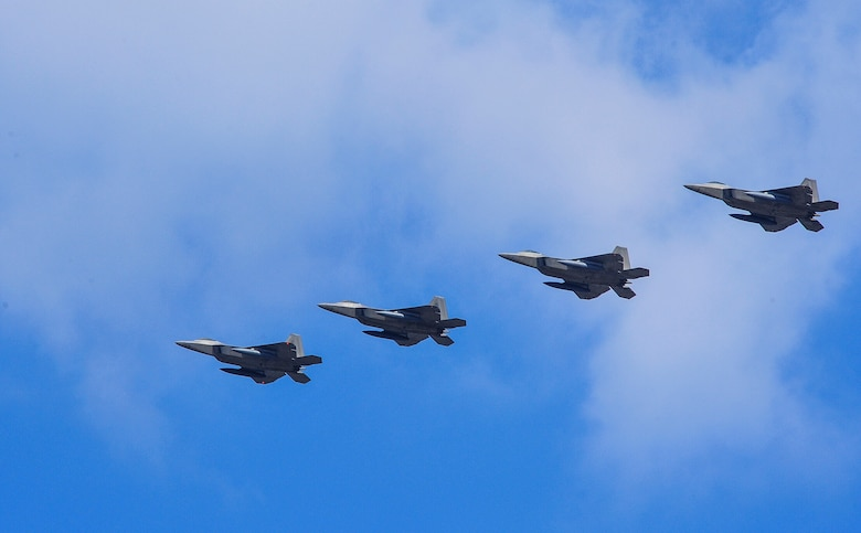 """Four U.S. Air Force F-22 """"Raptor"""" fighter aircraft from Kadena Air Base, Japan, conducted a flyover in the vicinity of Osan Air Base, South Korea, in response to recent provocative action by North Korea Feb. 17, 2016. The Raptors were joined by four F-15 Slam Eagles and U.S. Air Force F-16 Fighting Falcons. The F-22 is designed to project air dominance rapidly and at great distances and currently cannot be matched by any known or projected fighter aircraft.  (U.S. Air Force photo by Song, Kyong Hwan/Released)"""