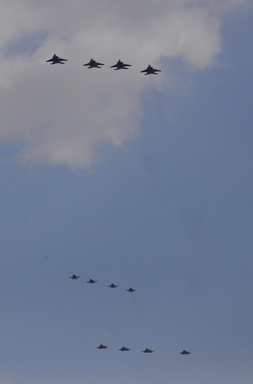 """Four U.S. Air Force F-22 """"Raptor"""" fighter aircraft from Kadena Air Base, Japan, conducted a flyover in the vicinity of Osan Air Base, South Korea, in response to recent provocative action by North Korea Feb. 17, 2016. The Raptors were joined by four F-15 Slam Eagles and U.S. Air Force F-16 Fighting Falcons. The F-22 is designed to project air dominance rapidly and at great distances and currently cannot be matched by any known or projected fighter aircraft.   (U.S. Air Force photo by Staff Sgt. Amber Grimm/Released)"""