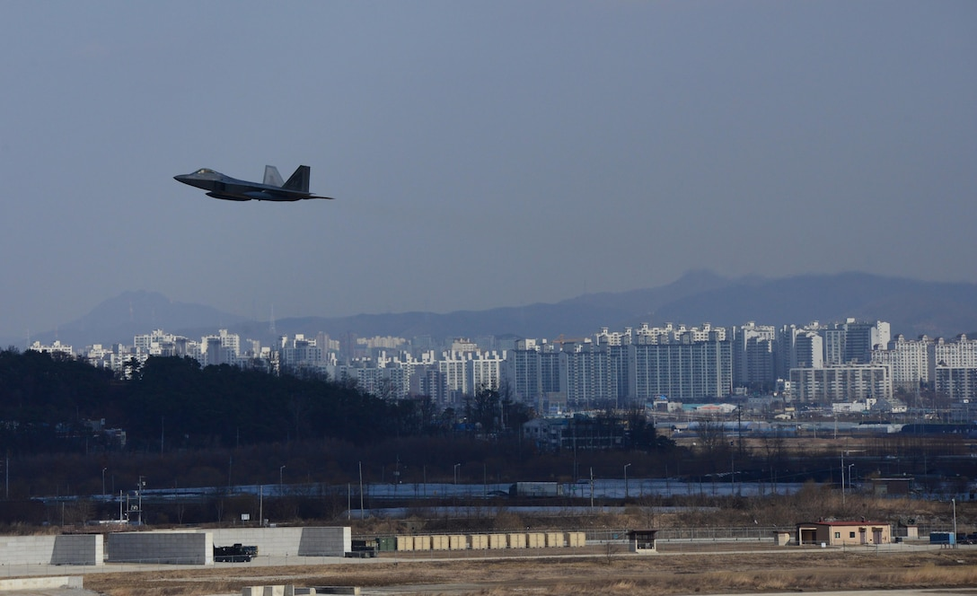 """A U.S. Air Force F-22 """"Raptor"""" fighter aircraft from Kadena Air Base, Japan, conducted a flyover in the vicinity of Osan Air Base, South Korea, in response to recent provocative action by North Korea Feb. 17, 2016. Four Raptors were joined by four F-15 Slam Eagles and U.S. Air Force F-16 Fighting Falcons. The F-22 is designed to project air dominance rapidly and at great distances and currently cannot be matched by any known or projected fighter aircraft.   (U.S. Air Force photo by Staff Sgt. Amber Grimm/Released)"""