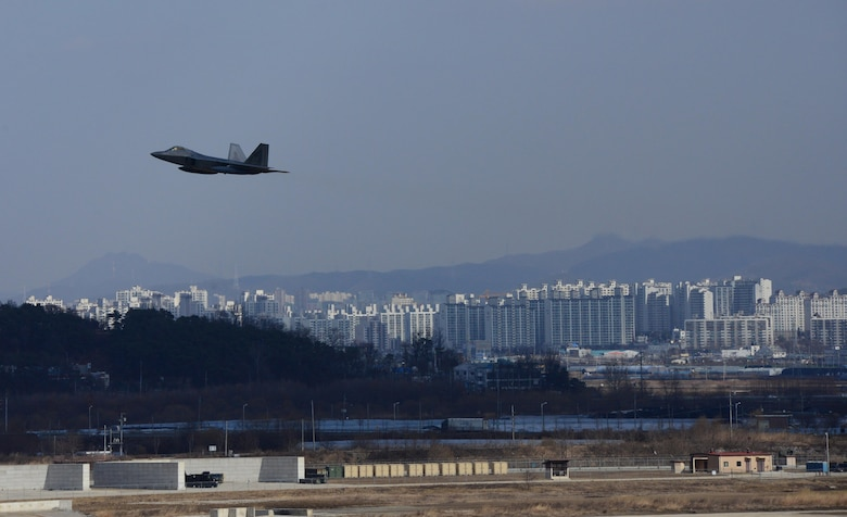 "A U.S. Air Force F-22 ""Raptor"" fighter aircraft from Kadena Air Base, Japan, conducted a flyover in the vicinity of Osan Air Base, South Korea, in response to recent provocative action by North Korea Feb. 17, 2016. Four Raptors were joined by four F-15 Slam Eagles and U.S. Air Force F-16 Fighting Falcons. The F-22 is designed to project air dominance rapidly and at great distances and currently cannot be matched by any known or projected fighter aircraft.  