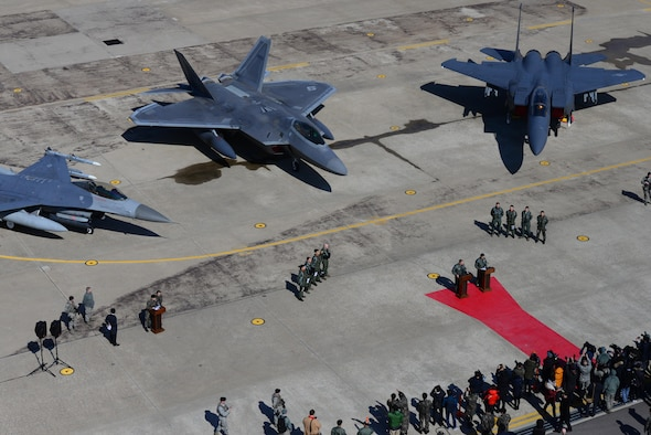 A U.S. Air Force F-22 Raptor fighter aircraft from Joint Base Elmendorf-Richardson, Alaska, is flanked by an F-16 Fighting Falcon and a Republic of Korea air force F-15 Slam Eagle at Osan Air Base, ROK, Feb. 17,2016. The Raptor was part of a flyover formation of 12 aircraft demonstrating the strength of the ROK/U.S. alliance in response to recent provocative actions by North Korea.  (U.S. Air Force photo by Staff Sgt. Amber Grimm/Released)