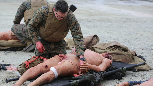 U.S. Navy Petty Officer Second Class Aaron Matthess, a hospital corpsman with 2nd Medical Battalion, treats a casualty during a tactical combat casualty care exercise at Marine Corps Base Camp Lejeune, N.C., Feb. 12, 2016. The extent of the injuries sailors had to treat on their patients included penetrating chest trauma, shrapnel penetration, amputation, airway obstructions and facial trauma.
