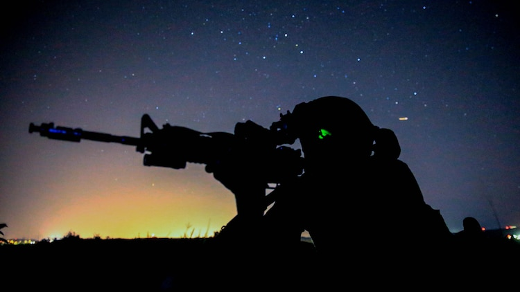 A Marine provides security for his team during the night portion of a tactical recovery of aircraft and personnel, or TRAP, training scenario at Marine Corps Base Camp Pendleton, California, Feb. 8, 2016. TRAP is used to tactically recover personnel, equipment or aircraft by inserting the recovery force to the objective location. The Marine is with Weapons Company, 2nd Battalion, 4th Marine Regiment, 1st Marine Division.