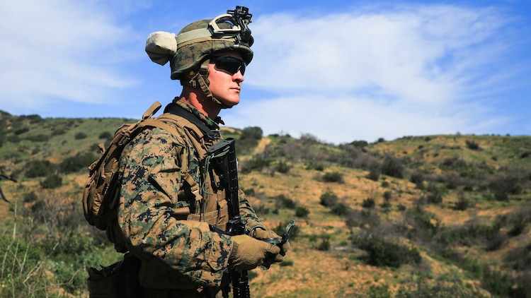 A Marine orients his team toward the location of a simulated downed pilot during a tactical recovery of aircraft and personnel, or TRAP, training scenario at Camp Pendleton, Calif., Feb. 10, 2016. The TRAP training is meant to prepare Marines on essential procedures used to tactically recover personnel, equipment or aircraft by inserting the recovery force to the objective location. The Marine is with 2nd Battalion, 4th Marine Regiment, 1st Marine Division. (U.S. Marine Corps photo by Lance Cpl. Devan K. Gowans/Released)