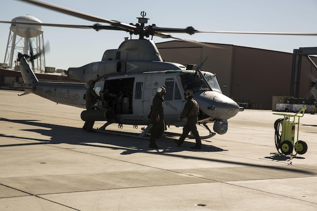 "Marines with Marine Light Attack Helicopter Squadron 469 (HMLA-469), based out of Marine Corps Air Station Camp Pendleton, Calif., perform pre-flight inspections on a UH-1Y ""Venom"" aboard Marine Corps Air Station Yuma, Ariz., Friday, Feb. 5, 2016."