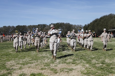 U.S. Marines with the 2nd Marine Division Band march during a post and relief ceremony aboard Naval Station Norfolk, Va., April 2, 2015. Sgt. Maj. William Frye relinquished his duties as the Regimental Sgt. Maj. of the Marine Corps Security Force Regiment to Sgt. Maj. Darby Noonan during a post and relief ceremony. (U.S. Marine Corps photo by Sgt. Esdras Ruano/Released)