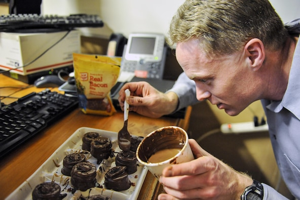 """Dan Johnson, the 455th Expeditionary Mission Support Group contract augmentation program manager and treat maker, makes a batch of """"Dead Elvis"""" at Bagram Airfield, Afghanistan, on Feb. 16, 2016. The """"Dead Elvis"""" is a deployed confection created using peanut butter Oreos, bacon and chocolate. (U.S. Air Force photo/Tech. Sgt. Nicholas Rau)"""
