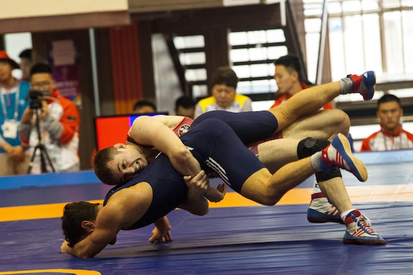 U.S. Wrestler Valdyslav Dombrovskyy during the men's freestyle wrestling match against Germany. The 6th CISM World Games provides the opportunity for the athletes of over 100 different nations to come together and enjoy friendship through sport. The sixth annual CISM World Games are being held aboard Mungyeong, South Korea, Sept. 30-Oct. 11. (Photo by Sgt. Ashley N. Cano)