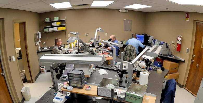 Dental laboratory technicians with the 2nd Dental Squadron process service requests at Barksdale Air Force Base, La., Feb. 12, 2016. The 2nd DS creates a variety of products including nightguards, retainers, crowns, bridges and implants to assist with dental care. (U.S. Air Force photo/Airman 1st Class Mozer O. Da Cunha)