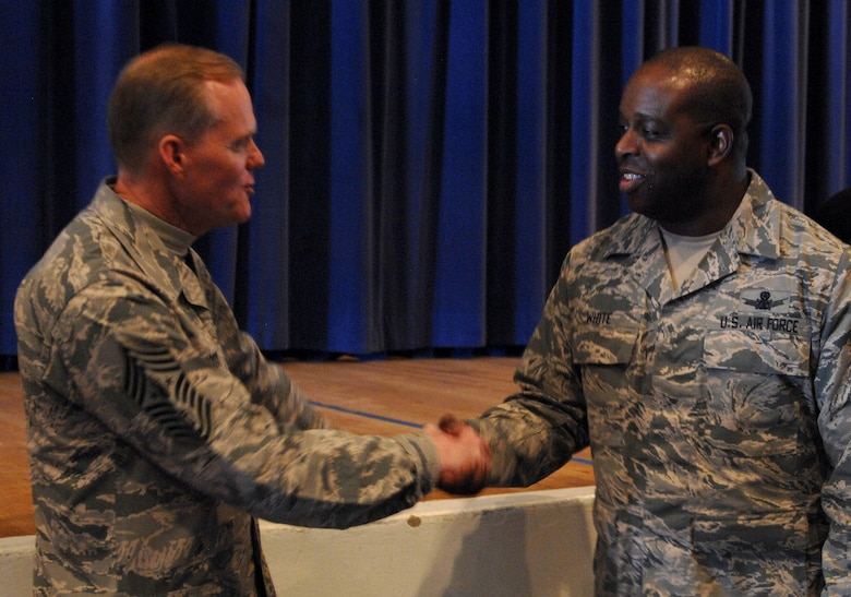 Chief Master Sgt. of the Air Force James A. Cody shakes hands with Master Sgt. Carlo White, of the 3rd Space Operations Squadron from Schriever Air Force Base, Colo., Feb. 11, 2016, after the NCO all call at the Peterson AFB auditorium. NCOs from the North American Air Defense Command, U.S. Northern Command and nearby bases completely filled the 300-plus person venue. (U.S. Air Force photo/Master Sgt. Chuck Marsh)