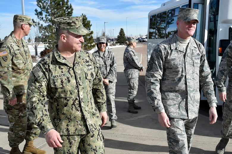 Chief Master Sgt. of the Air Force James A. Cody, right, is greeted by Fleet Master Chief Terrence Molidor, the command senior enlisted advisor for the North American Air Defense Command and U.S. Northern Command, Feb. 11, 2016, at Peterson Air Force Base, Colo. Cody toured the commands' facility, met with senior enlisted members and recognized several enlisted service members for excellence. (U.S. Air Force Photo/Master Sgt. Andy Bellamy)