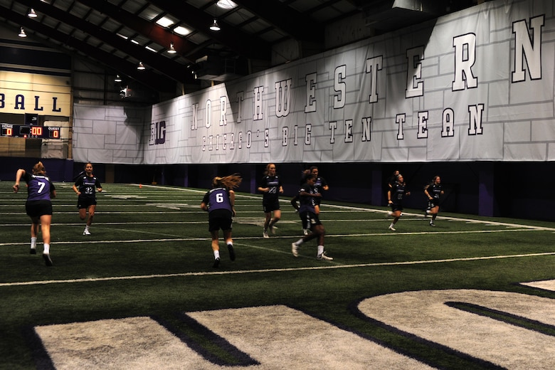 Chicago-area Marines led the Northwestern University women's lacrosse team in a team-building and physical conditioning exercise at the university's Nicolette indoor practice facility in Evanston, Ill., Feb. 16, 2016. The Marines taught the players how to react quickly and effectively against rapidly approaching and unforeseeable threats, drawing comparisons from the battlefield and the lacrosse field.