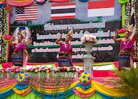 School children perform a traditional Thai dance during the Ban Phromnimit construction project dedication ceremony Feb. 16 at Sakeao, Thailand. The construction at Ban Phromnimit was one of six humanitarian civic action sites in which the Thai, U.S. and partner nation's militaries will work together on civic programs during Cobra Gold 2016. The HCA programs will help improve the quality of life, as well as the general health and welfare of civilian residents in the exercise areas.