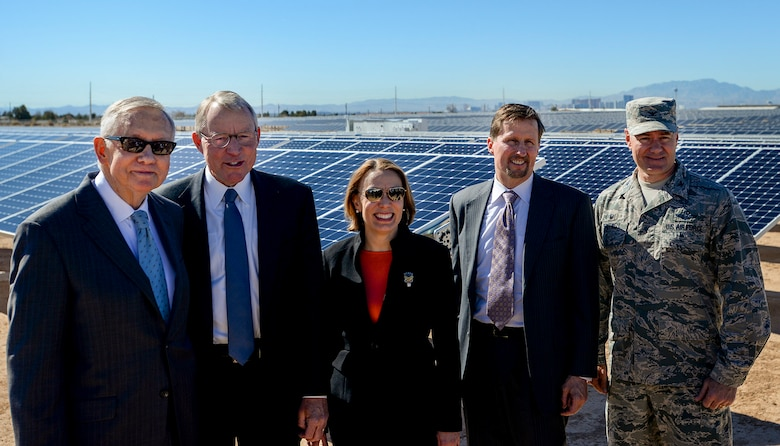 From left to right, Sen. Harry Reid; Paul Caudill, NV Energy CEO; Miranda A.A. Ballentine, Assistant Secretary of the Air Force for Installations, Environment and Energy; Tom Werner, SunPower Corp. CEO; and Col. Richard Boutwell, 99th Air Base Wing commander, pose for a photo at the Nellis Solar Array II Feb. 16, 2016, Nellis Air Force Base, Nev. The U.S. Air Force unveiled the new array during a dedication ceremony on base. (U.S. Air Force photo by Airman 1st Class Kevin Tanenbaum)
