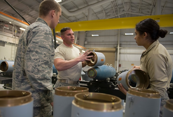 Senior Airman Ben Guthals, 57th Maintenance Squadron munitions systems journeyman, guides 2nd Lt. Thomas Tincher and 2nd Lt. Amanda Ryder, 366th Equipment Maintenance Squadron crew members, through the process of assembling guided bomb unit-12 Paveway IIs, Feb. 8, 2016, at Mountain Home Air Force Base, Idaho. The GBU-12s were used during a F-35A Lightning II deployment test at the nearby range complex. (U.S. Air Force photo by Airman Chester Mientkiewicz/RELEASED)