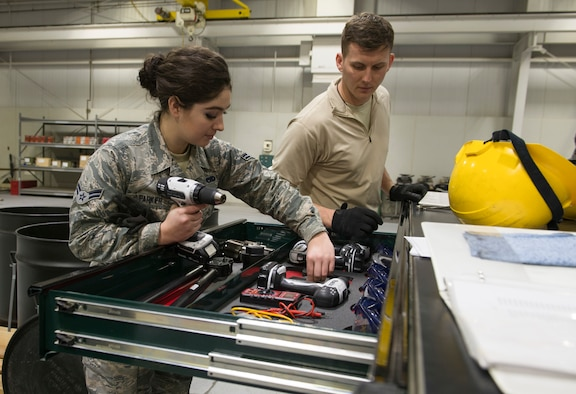 Airman 1st Class Rachel Parker, 366th Equipment Maintenance Squadron  crew member and Staff Sgt. Nick Olmsted, 366th EMS, crew chief, gather tools needed to assemble guided bomb unit-12 Paveway IIs, Feb. 8, 2016, at Mountain Home Air Force Base, Idaho. The GBU-12s were assembled to be used during an initial operating capability test for the F-35A Lightning IIs. (U.S. Air Force Photo by Airman Chester Mientkiewicz/RELEASED)