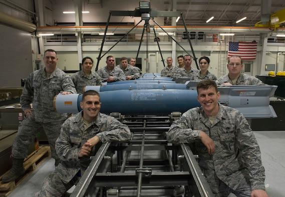 Members from the 366th Equipment Maintenance Squadron and the 57th Maintenance Squadron gather for a group photo after assembling guided bomb unit-12s Paveway IIs, Feb. 8, 2016, at Mountain Home Air Force Base, Idaho. The bomb assembly marked the first time the GBU-12s were assembled for the F-35A Lightning II on Mountain Home AFB. (U.S. Air Force photo by Airman Chester Mientkiewicz/RELEASED)