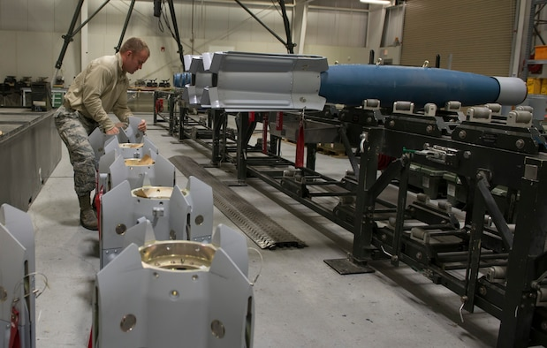 Tech. Sgt. Chris Brown, 57th Maintenance Squadron munitions systems craftsman, prepares the tails of the guided bomb unit-12 Paveway IIs for assembly, Feb. 8, 2016, at Mountain Home Air Force Base, Idaho. The GBU-12s were assembled to be used for various training scenarios to assess the deployment capability of the F-35A Lightning II. (U.S. Air Force photo by Airman Chester Mientkiewicz/RELEASED)
