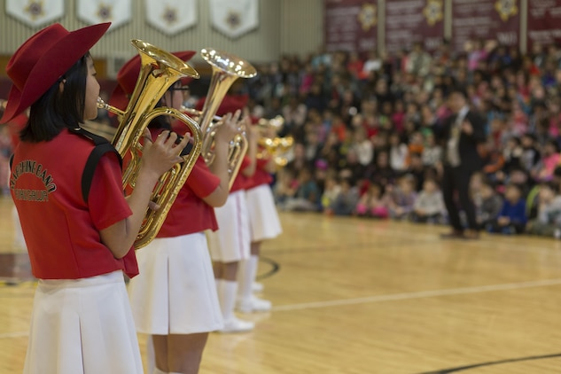 The Fukugawa Elementary School marching band performs at Matthew C. Perry Elementary School at Marine Corps Air Station Iwakuni, Japan, during a cultural exchange Feb. 11, 2016. Fukugawa Elementary School is a member of the Shunan International Children's Club that visits M.C. Perry Elementary School annually. The 6th annual performance included karate, traditional Japanese dance, a marching band and musical choir.