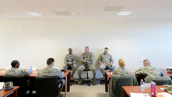 (From left) U.S. Air Force Chief Master Sergeants Carey Jordan, 31st Civil Engineer Squadron superintendent, Eric Markel, 31st Maintenance Group superintendent, and Senior Master Sgt. Bobby Hickman, 31st Operations Support Squadron superintendent, field questions on the new Enlisted Performance Report process during an NCO Professional Enhancement Seminar at Aviano Air Base, Italy, Feb. 11, 2016. The three-day seminar that covered topics ranging from the Enlisted Force Structure to healthy living and focused primarily on junior NCOs taking care of Airmen. (U.S. Air Force photo by Staff Sgt. R.J. Biermann/Released)