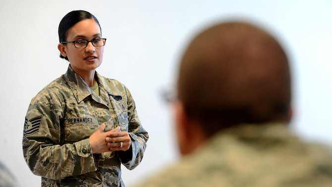 U.S. Air Force Tech. Sgt. Maribelle Hernandez, 31st Force Support Squadron Manpower analyst, discusses resource management during an NCO Professional Enhancement Seminar at Aviano Air Base, Italy, Feb. 11, 2016. The three-day seminar covered topics ranging from the Enlisted Force Structure to healthy living and focused primarily on junior NCOs taking care of Airmen. (U.S. Air Force photo by Staff Sgt. R.J. Biermann/Released)