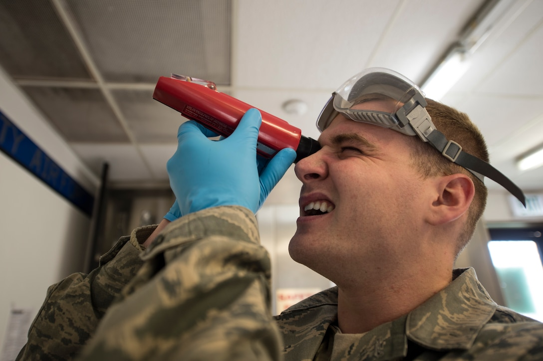 U.S. Air Force Senior Airman Alex Keely, a 52nd Logistics Readiness Squadron fuels laboratory technician, reads a fuel system icing inhibitor test result using a refractometer at Spangdahlem Air Base, Germany, Feb. 16, 2016. The fuels lab ensures jet fuel is properly mixed and free of contaminants before it is used by any Air Force aircraft. (U.S. Air Force photo by Staff Sgt. Christopher Ruano/Released)