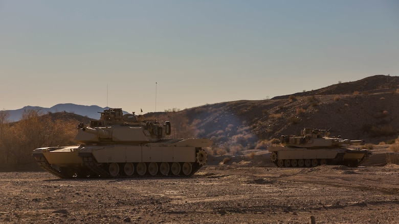 Two M1A1 Abrams Main Battle Tanks with Company A, 1st Tank Battalion,  post security along a road during a Tank Mechanized Assault Course as part of Integrated Training Exercise 2-16 in the Quackenbush Training Area at Marine Corps Air Combat Center Twentynine Palms, Calif. Feb. 9, 2016. ITX is designed to prepare units for combat, under the most realistic conditions possible, focusing on battalion and squad level training.