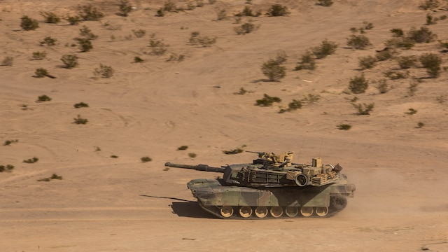 An M1A1 Abrams Main Battle Tanks with Company A, 1st Tank Battalion, scans for adversaries while traversing through the Quackenbush Training Area Tank Mechanized Assault Course as part of Integrated Training Exercise 2-16 at Marine Corps Air Combat Center Twentynine Palms, Calif. Feb. 9, 2016. ITX is designed to prepare units for combat, under the most realistic conditions possible, focusing on battalion and squad level training.