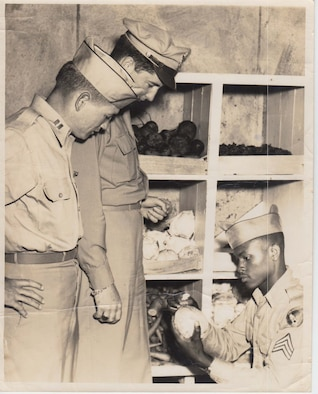 Capt. Harry C. Aderholt, the commander of Squadron F, 2123 Army Air Force, left, conducts a supply inventory at Maxwell Field in September 1945.  He was commander of a segregated African American unit at Maxwell Field.  Captain Aderholt eventually rose to the rank of brigadier general, U.S. Air Force, and was a prominent figure in Air Force Special Operations in the 1950s and 1960s. (Courtesy photo U.S. Air Force)
