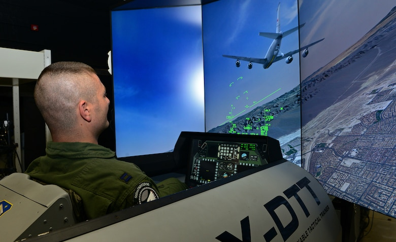 Capt. Matthew Sabraw, 555th Fighter Squadron F-16 Fighting Falcon pilot, operates an F-16 simulator, Dec. 12, 2013, at Aviano Air Base, Italy. Pilots adhere to a strict training program tailored to Aviano's mission of deter aggression, defend U.S. and NATO interests, and develop Aviano. (U.S. Air Force photo by Senior Airman Matthew Lotz/Released)