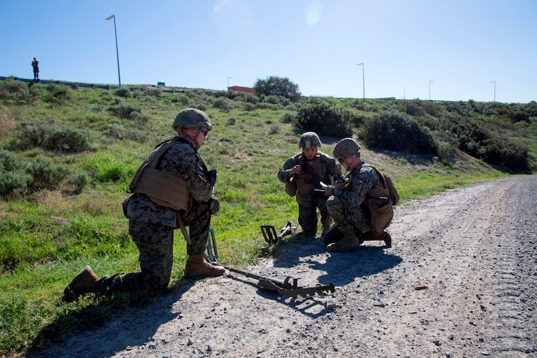 U.S. Marines call in for Explosive Ordnance Disposal technicians after discovering a possible IED during counter-IED training at Camp Pendleton, Feb. 12, 2016. The Marines were testing out the pilot course of Marine Corps Engineer School, Defeat the Device branch, Counter-IED Training Class. The Marines participating in the training are with Company A, 1st Combat Engineer Battalion, 1st Marine Division.