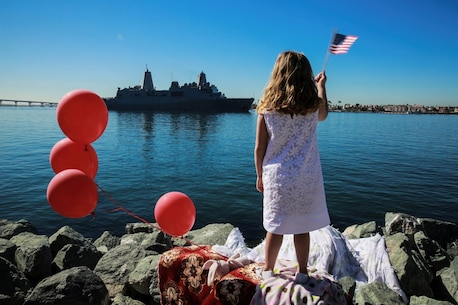 A Marine's daughter waves to the USS New Orleans where her father is departing with the 13th Marine Expeditionary Unit, I Marine Expeditionary Force, in San Diego Feb. 12, 2016. Her father is an infantry officer, deployed with the 13th MEU and is part of the Battalion Landing Team, 2nd Battalion, 1st Marine Regiment, I Marine Expeditionary Force. The 13th MEU is capable of conducting amphibious operations, crisis response and limited contingency operations and is beginning an estimated six-month deployment to the Western Pacific and Middle East. (U.S. Marine Corps photo by Lance Cpl. Caitlin Bevel)
