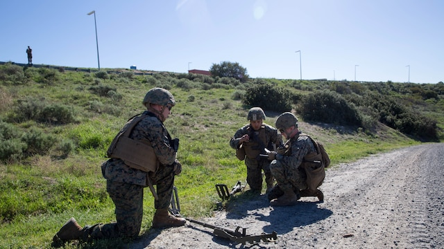U.S. Marines call in for Explosive Ordnance Disposal technicians after discovering a possible IED during counter-IED training at Marine Corps Base Camp Pendleton, Feb. 12, 2016. The Marines were testing out the pilot course of Marine Corps Engineer School, Defeat the Device branch, Counter-IED Training Class. The Marines participating in the training are with Company A, 1st Combat Engineer Battalion, 1st Marine Division.
